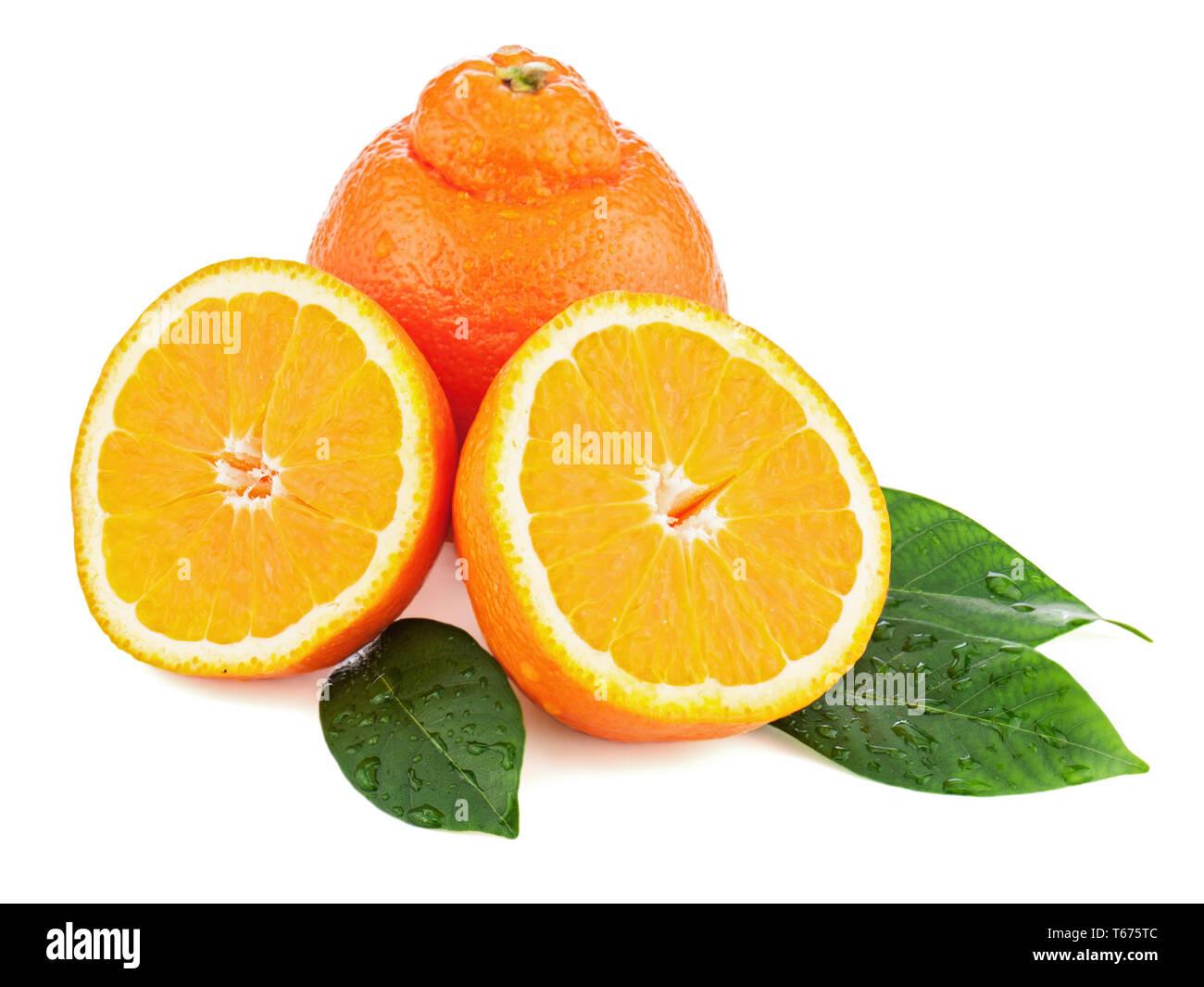 Fresh orange fruit with green leaves isolated on w - Stock Image
