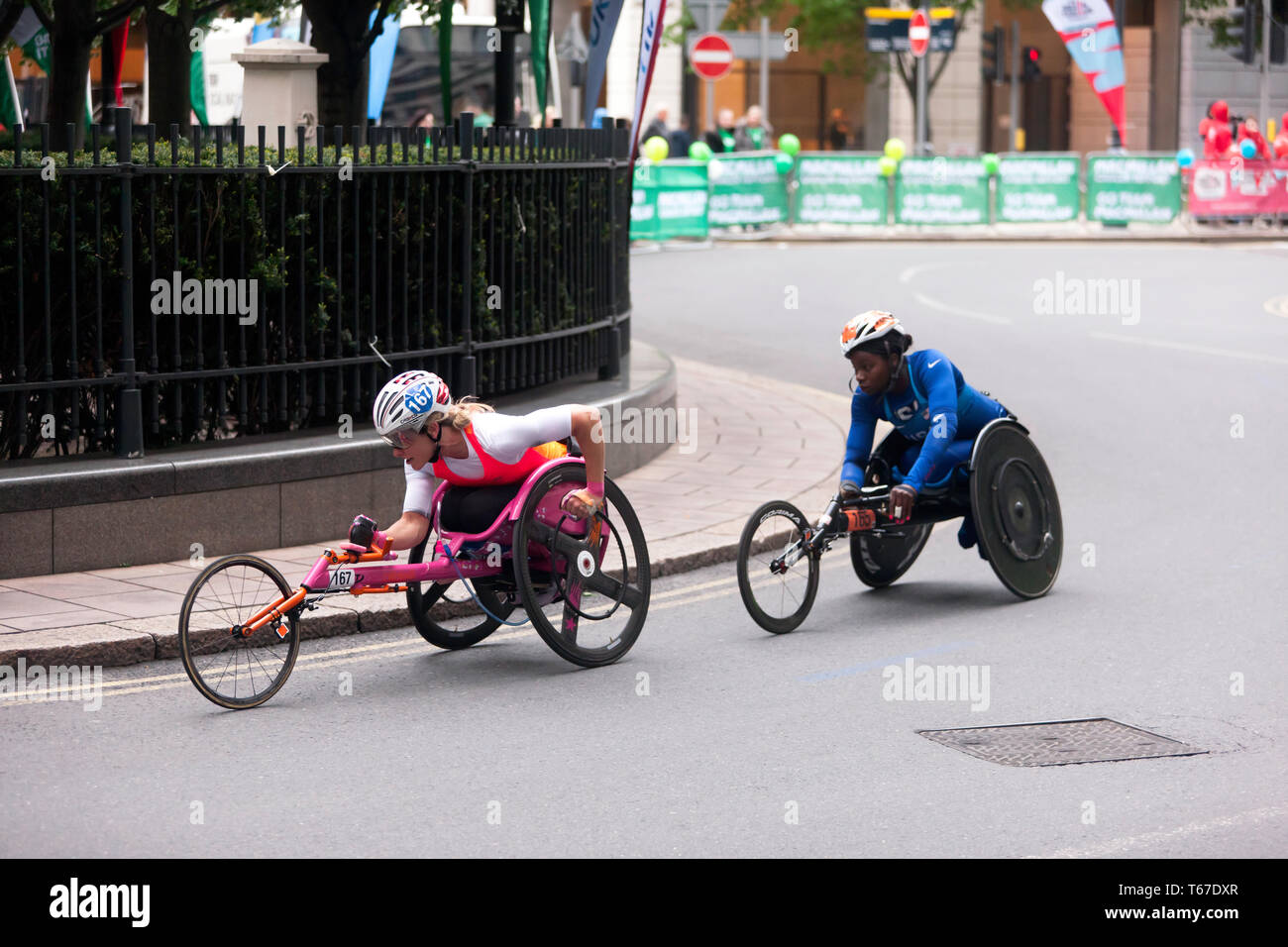 Mel Nicholls (GBR), and Michelle Wheeler (USA ) racing in the 2019 London Marathon Women's Elite Wheelchair Category (T53/T54).  Michelle  finish  14th in 02:03:37 and Mel finished 15th in the in a time of 02:03:39. - Stock Image
