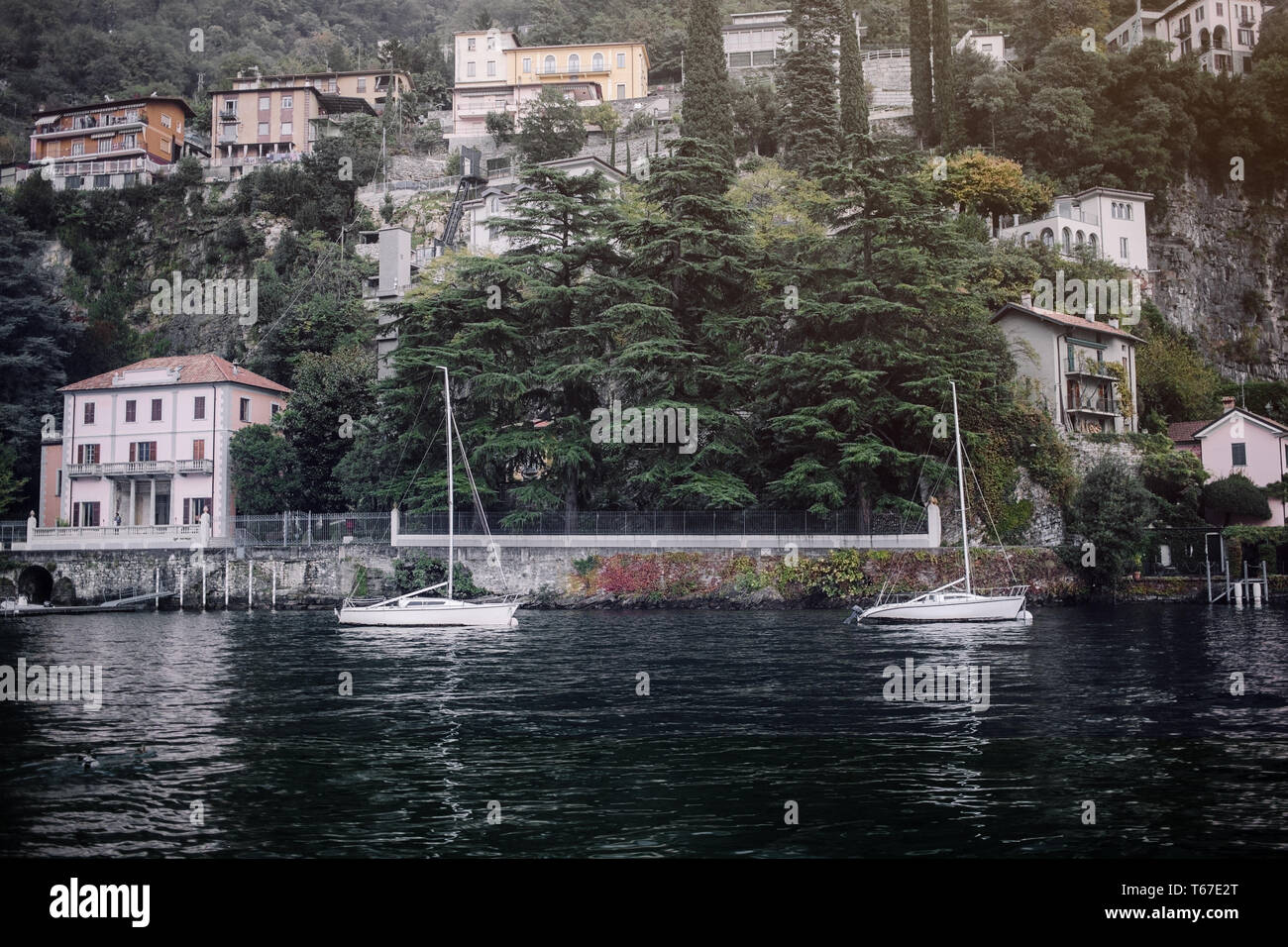 Villages on the hills in the evening. Old Village on Lake Como, Italy.Como lake is the most beautiful city around the lake.This is the most beautiful  Stock Photo