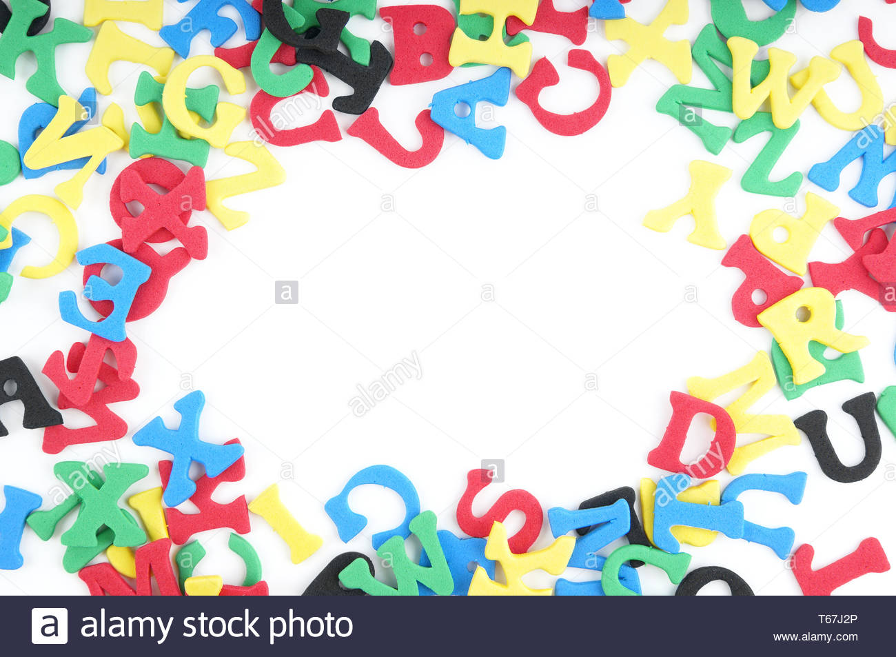 jumble of colorful foam rubber letters - Stock Image