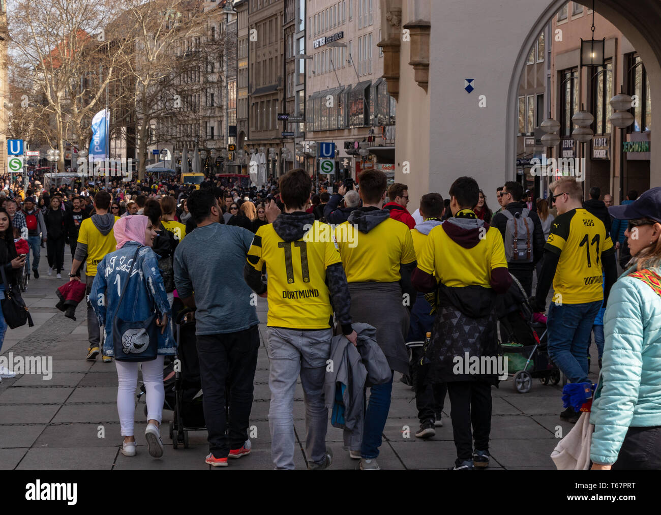 STACHUS, MUENCHEN, APRIL 6, 2019: bvb fans on the way to a public viewing location for the soccer game fc bayern munich vs bvb - Stock Image