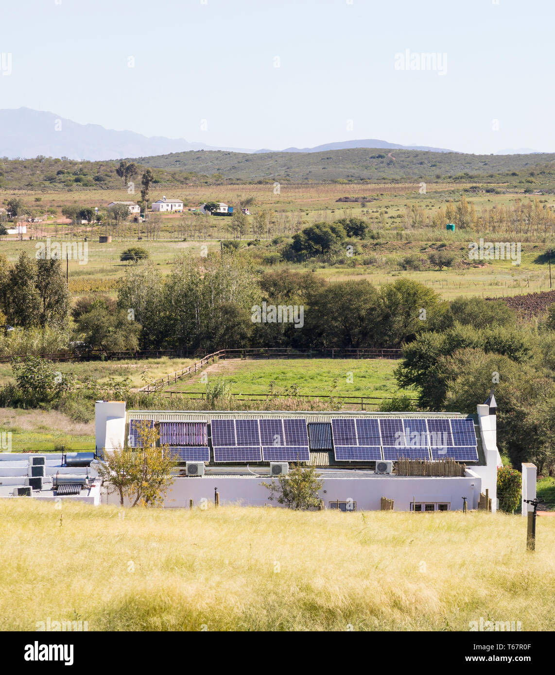 Environmentally friendly farmhouse with solar energy, Western Cape, South Africa, rooftop photovoltaic cells for household power and solar hot water g - Stock Image