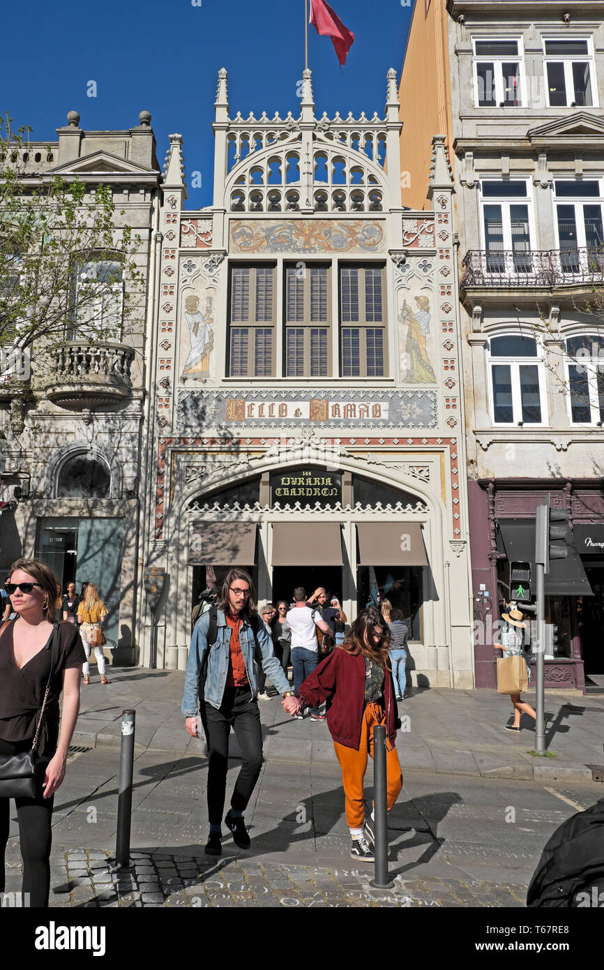 People outside the front of the Livraria Lello bookstore bookshop library described in Harry Potter books Porto Portugal Europe  KATHY DEWITT - Stock Image