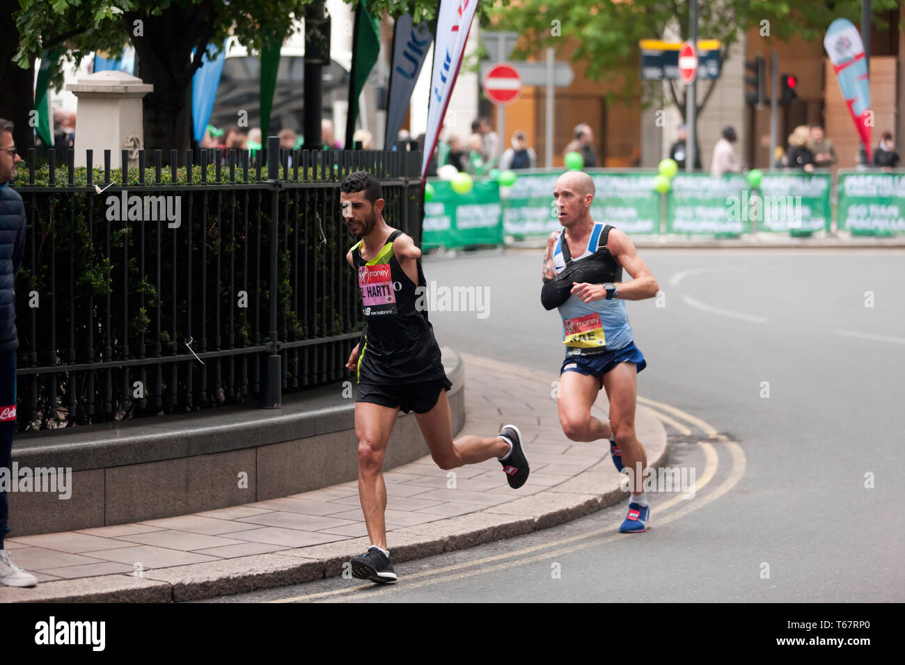 Abdelhadi  El Harti (MAR),  and Derek Rae (GBR), competing in the 2019 London Marathon they went on to finish 7th and 5th in times of 02:30:44 and 02:27:08 respectively. (3rd and 2nd in the T45/46 Category) Stock Photo
