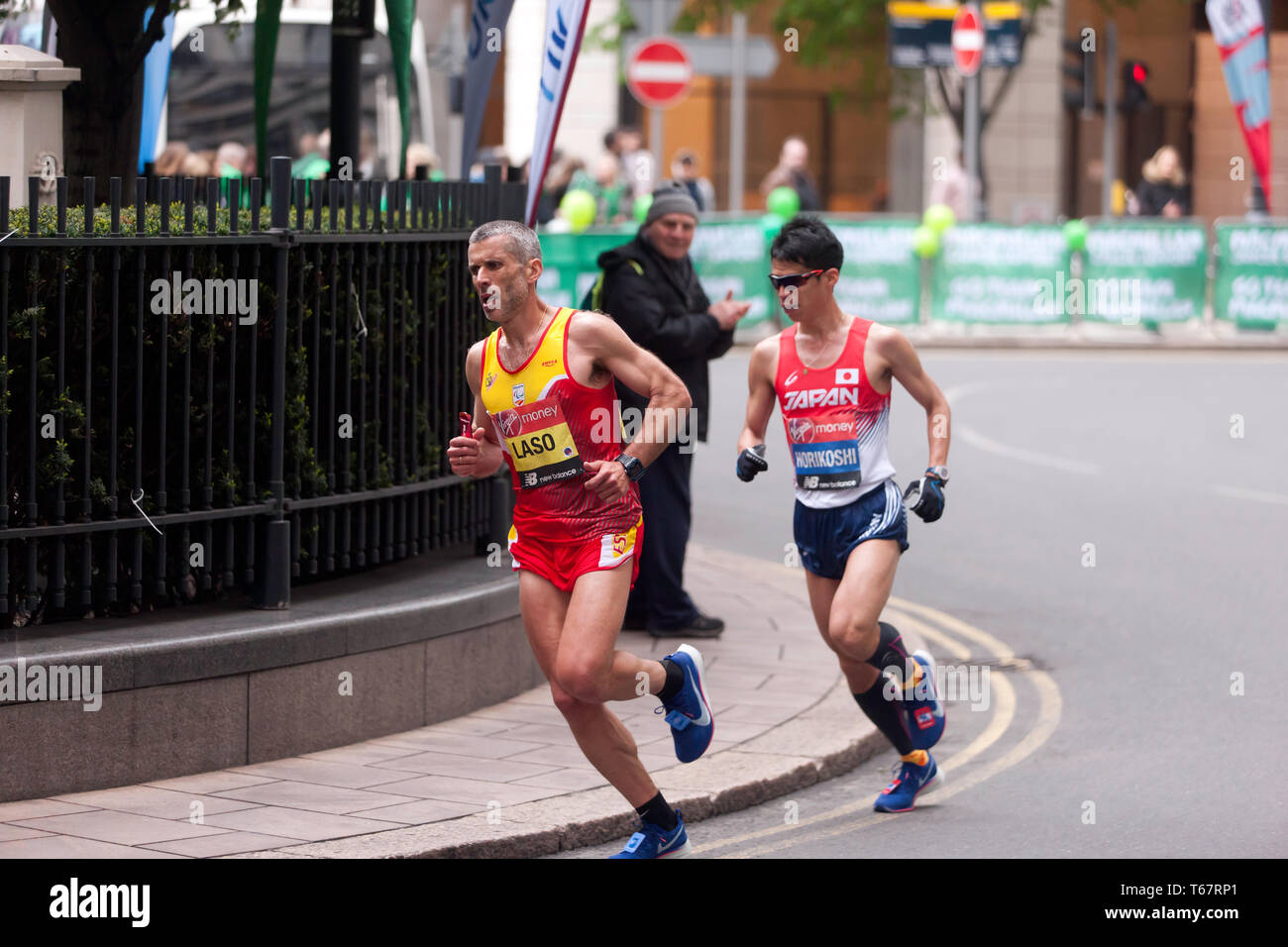 Alberto Suarez Laso (ESP),  and Tadashi Horikoshi (JPN), Competing in the 2019 London Marathon.  They went on to finish 3rd and 4th in times of 02:25:50 and 02:25:56 respectively (2nd and 3rd in the T11/12 Category). Stock Photo