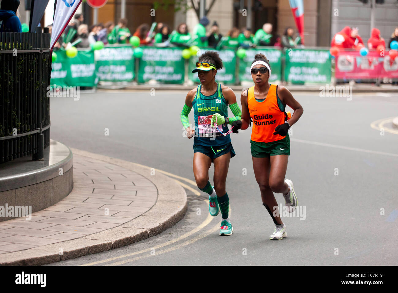 Edneusa de Jesus Santos Dorta with her guide runner, competing in the World Para 2019 London Marathon.  She went on to finish 2nd, in a time of 03:13:17 Stock Photo