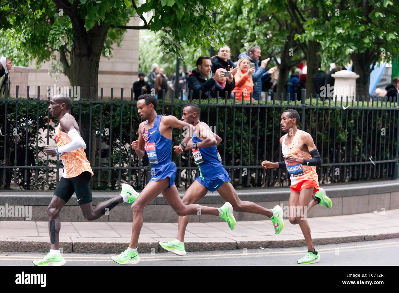 Eliud Kipchoge from Kenya, leading  the men's Elite 2019 London Marathon, from Mosinet Geremew, Tola Shura Kitata and Mule Wasihun, Eliud  went onto win in a time of 02:02:37 - Stock Image