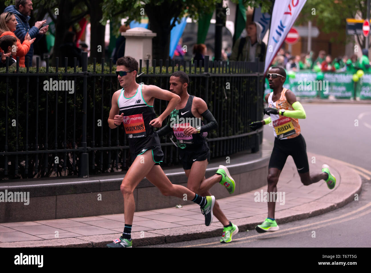 Callum Hawkins (GBR), Yassine Rachik (ITA) and Bashir Abdi (BEL), battling it out around Canary Wharf, during the 2019 London Marathon. They went on to finish 10th, 9th and 7th respectively  in the Men's elite race. Stock Photo