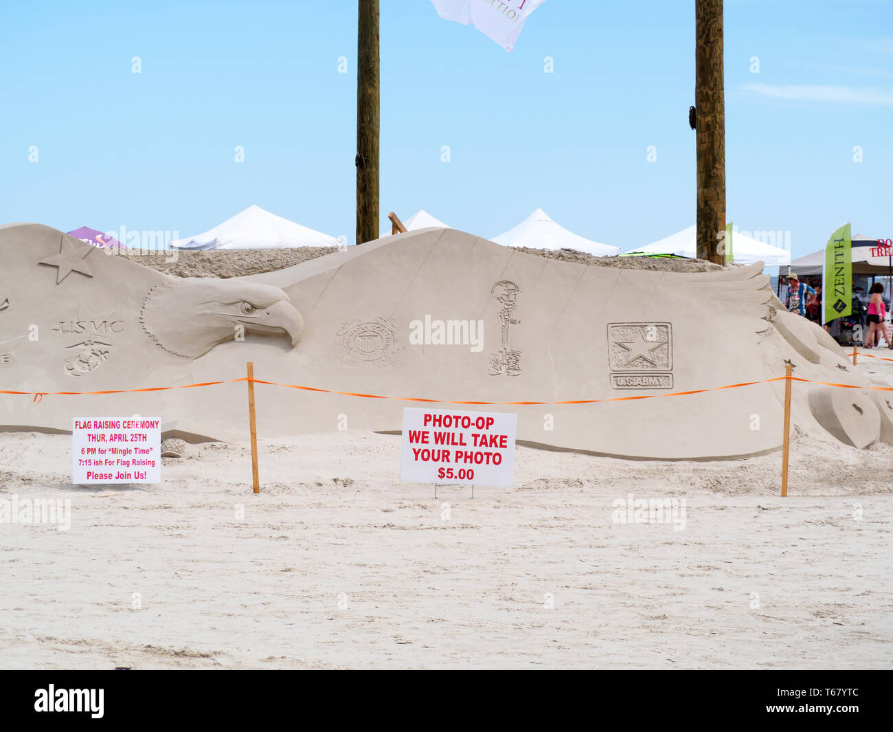 United States Armed Forces logos are featured on a massive eagle sculpted in sand at the 2019 Texas Sandfest in Port Aransas, Texas USA. - Stock Image