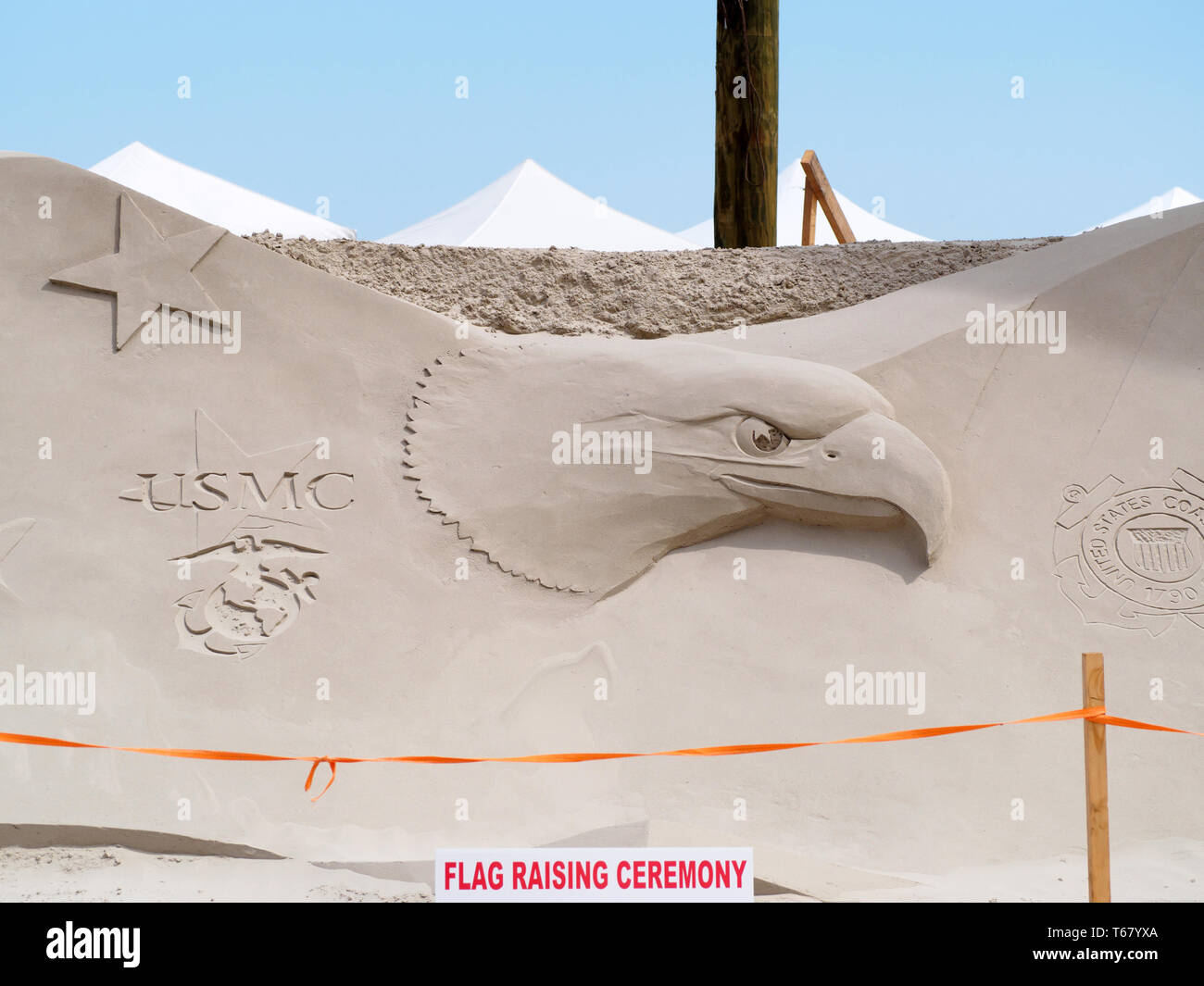 United States Marine Corps logo and eagle sculpted in sand at the 2019 Texas Sandfest in Port Aransas, Texas USA. - Stock Image
