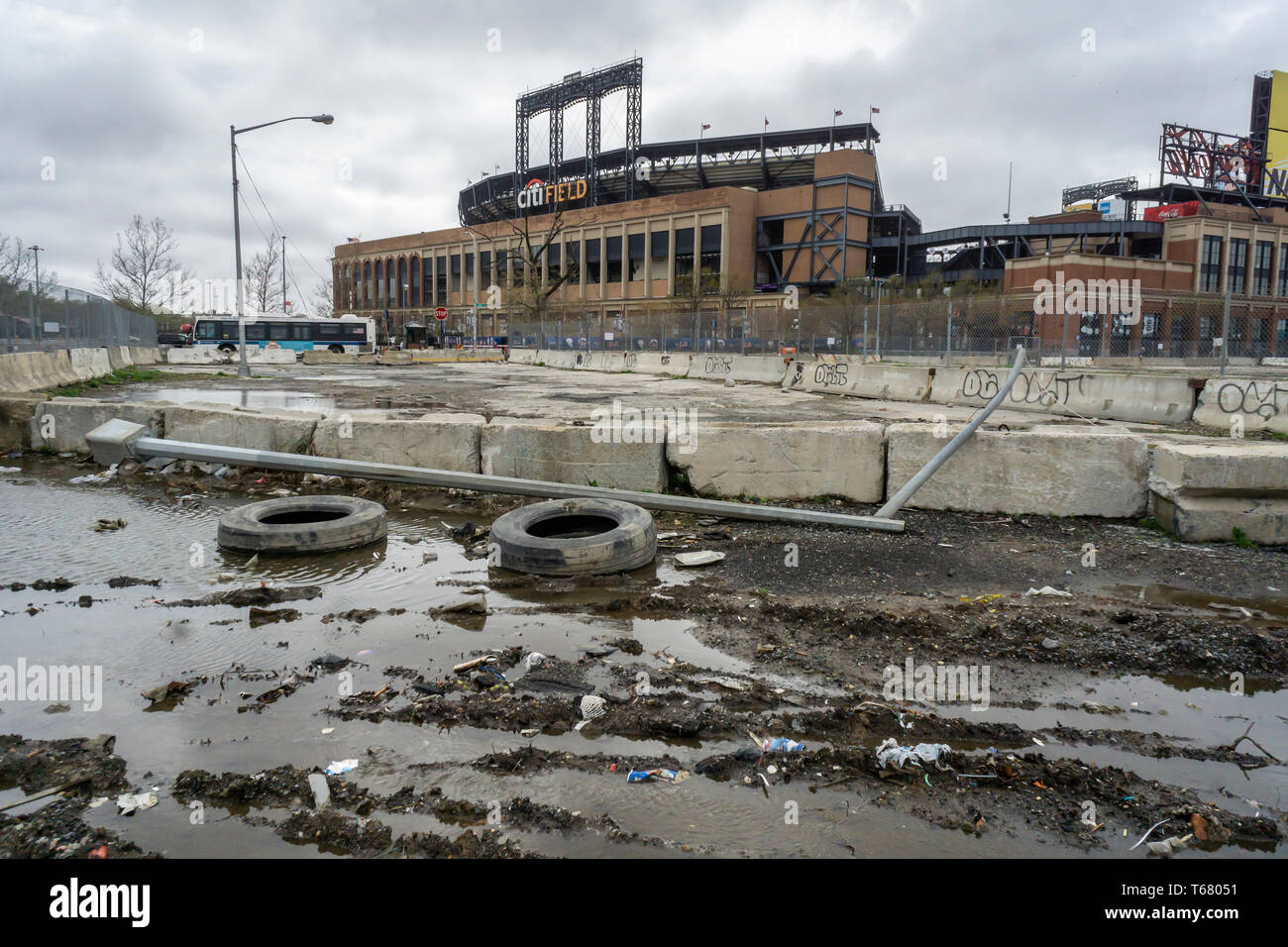 In the shadow of CitiField the automobile repair shops of Willets Point in the borough of Queens in New York are seen on Saturday, April 20, 2019. The city over the years evicted or bought out most of the businesses and the 61 acre area, called the 'Iron Triangle', an industrial area servicing car owners for decades, has few remaining repair shops (© Richard B. Levine) - Stock Image