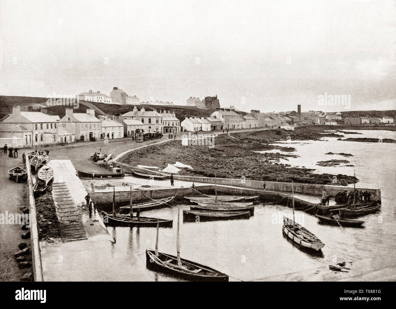 A 19th Century view of Portstewart, a small seaside resort in County Derry, aka County Londonderry, in Northern Ireland. Its harbour and scenic coastal paths form an Atlantic promenade leading to 2 miles of the golden Portstewart Strand. It developed into a modest size seaside resort in the mid 19th century under the influence of a local landlord, John Cromi, influenced greatly by the Sabbatarian sensitivities of the Cromies and the consequent resistance to a railway connection in the mid 19th century. - Stock Image