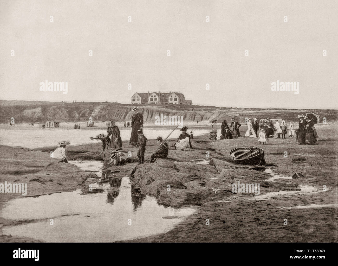 A 19th Century scene of Victorian folk on East Strand in front of the Great Northern Hotel in Bundoran, a town in County Donegal, Ireland. The town is a popular seaside resort, and tourism has been at the heart of the local economy since 1777. - Stock Image