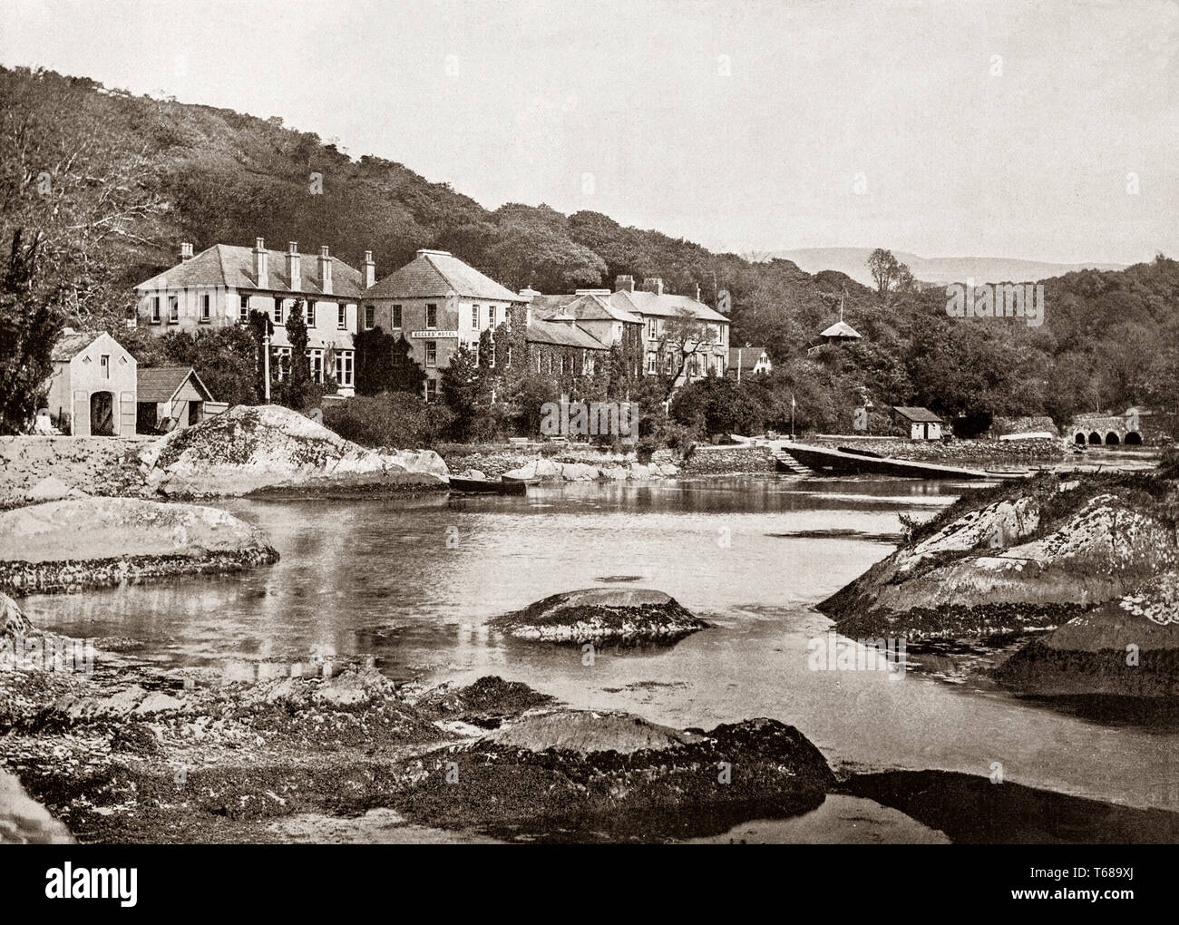 19th Century view of Eccles Hotel in Glengarriff, a village in the Beara Peninsula of County Cork, Ireland. Known internationally as a tourism venue, it boasts many natural attractions. It sits at the northern head of Glengarriff Bay, a smaller enclave of Bantry Bay. - Stock Image