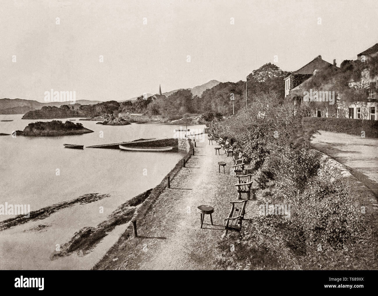 19th Century view of the Esplanade in Glengarriff, a village in the Beara Peninsula of County Cork, Ireland. Known internationally as a tourism venue, it boasts many natural attractions. It sits at the northern head of Glengarriff Bay, a smaller enclave of Bantry Bay. - Stock Image
