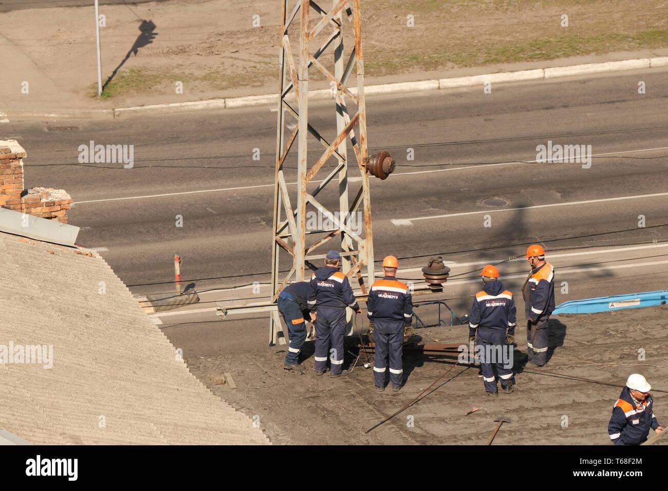 Kremenchug, Poltava region, Ukraine, April 9, 2019, improvement of the city, repair of power grids on the roof of the building Stock Photo