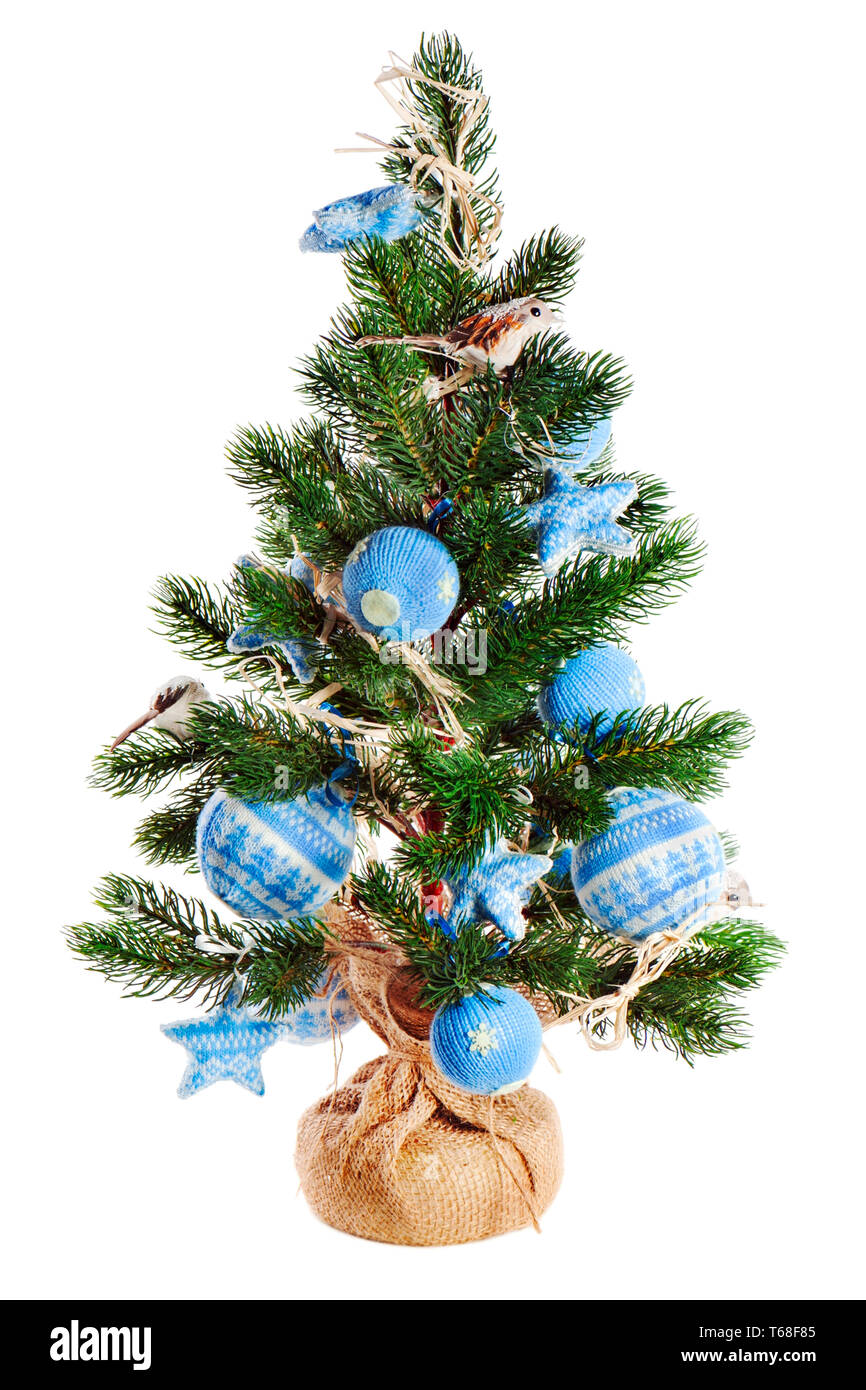 Christmas fir tree decorated with toys isolated on white background. Stock Photo