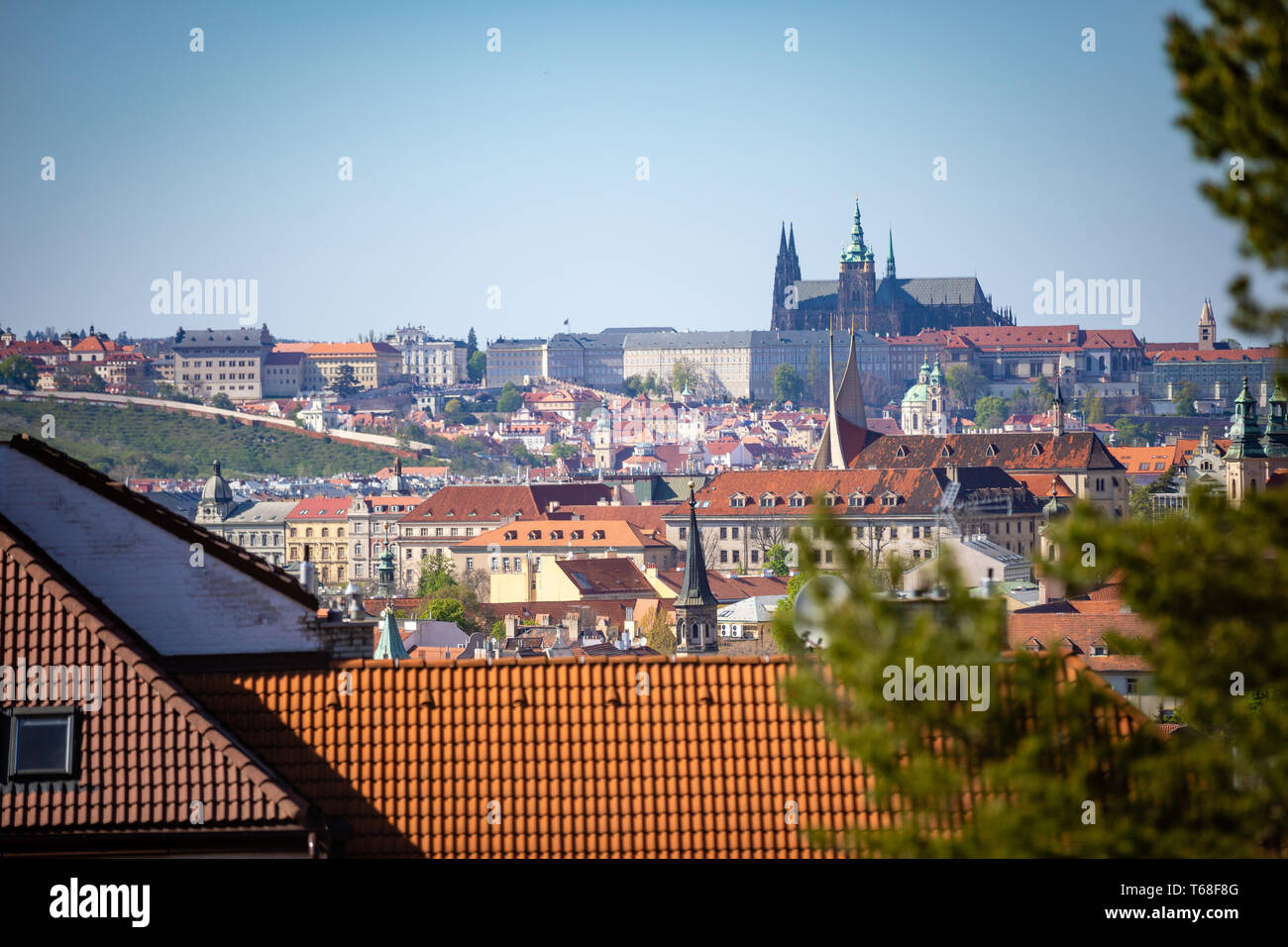 View of Prague Castle over red roof from Vysehrad area at sunset lights, Prague, Czech Republic - Stock Image
