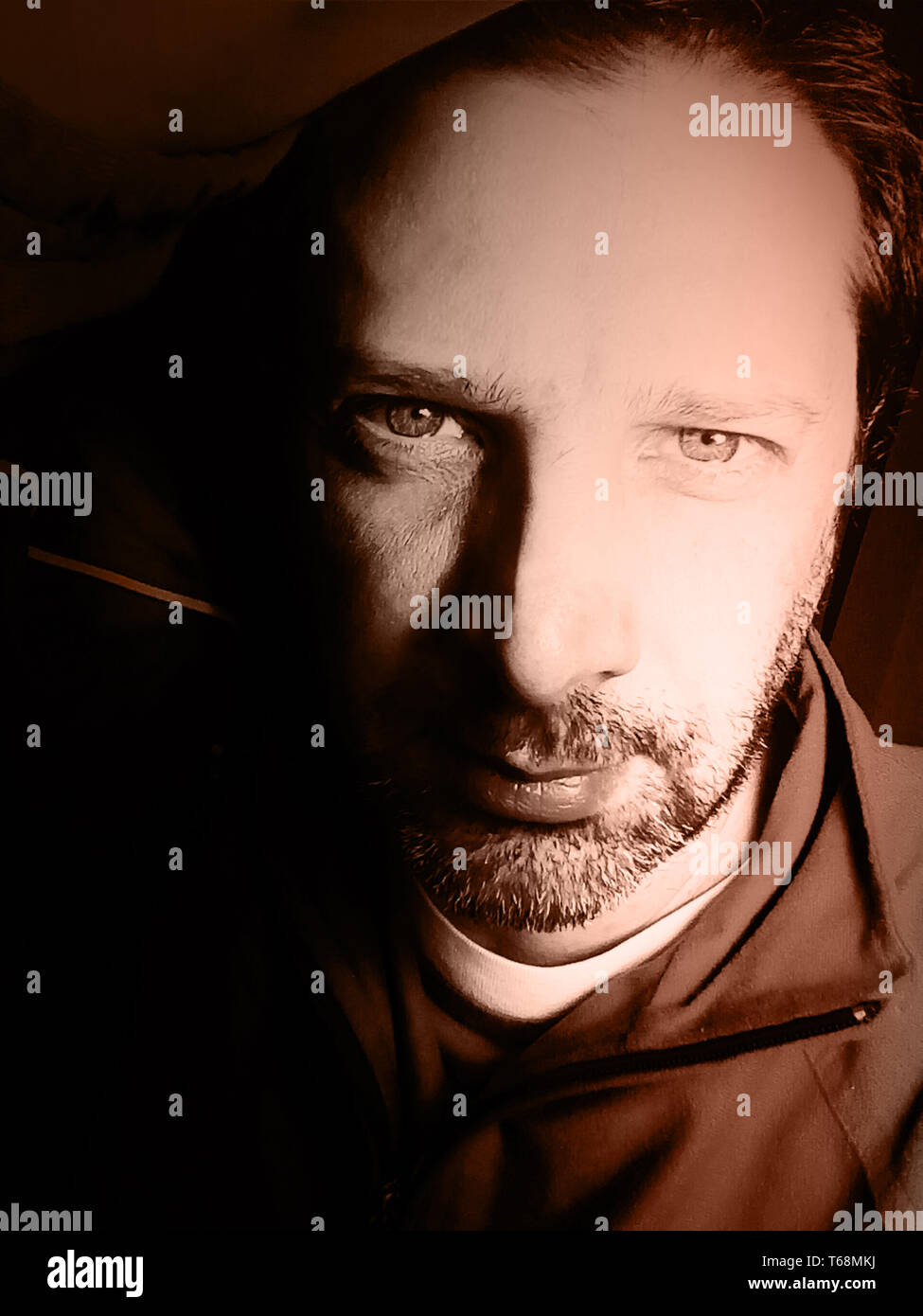 Portrait of a man in sepia tones - photography - Stock Image