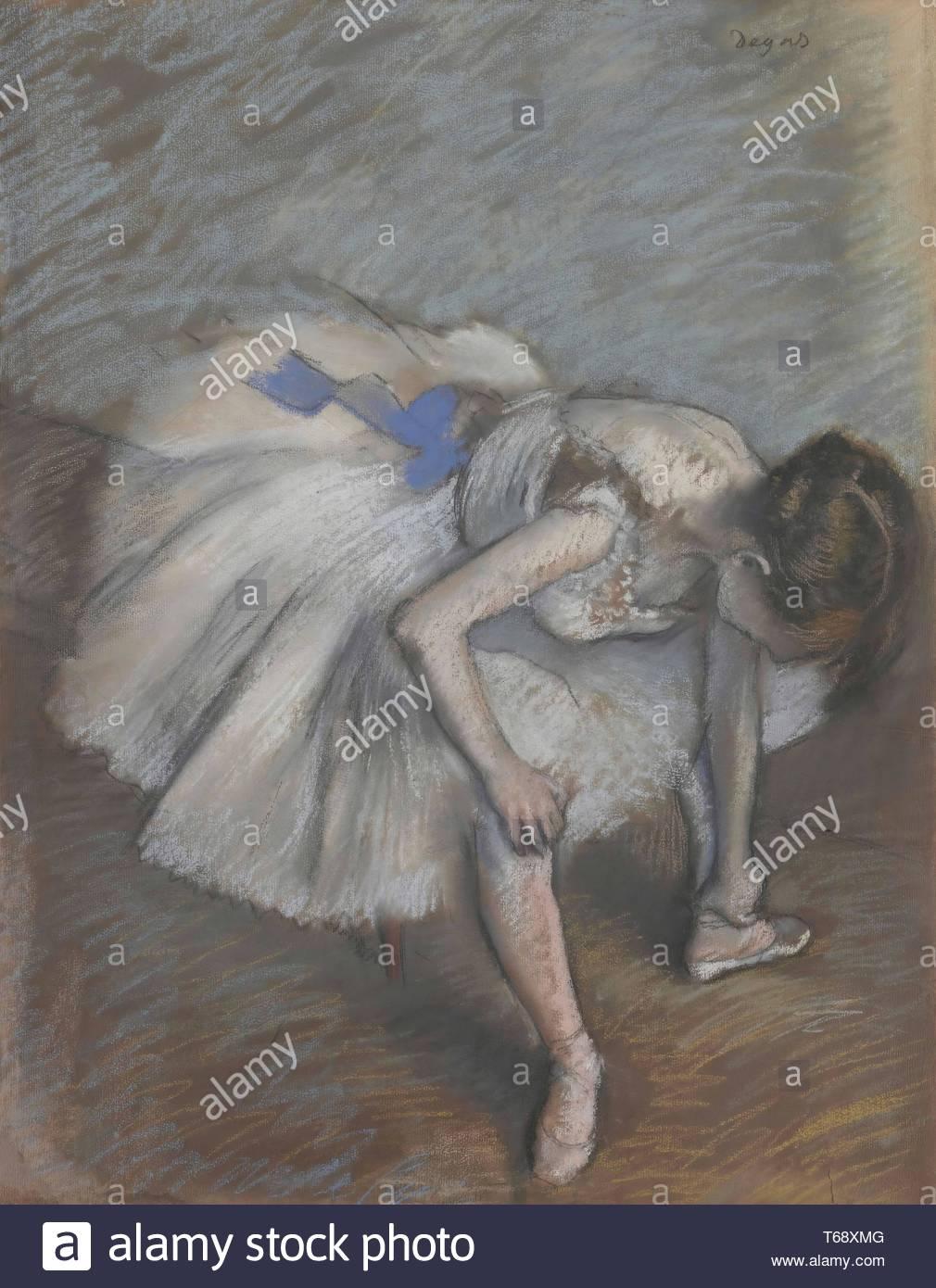 Edgar Degas-Seated dancer leaning forward, massaging her left foot - Stock Image