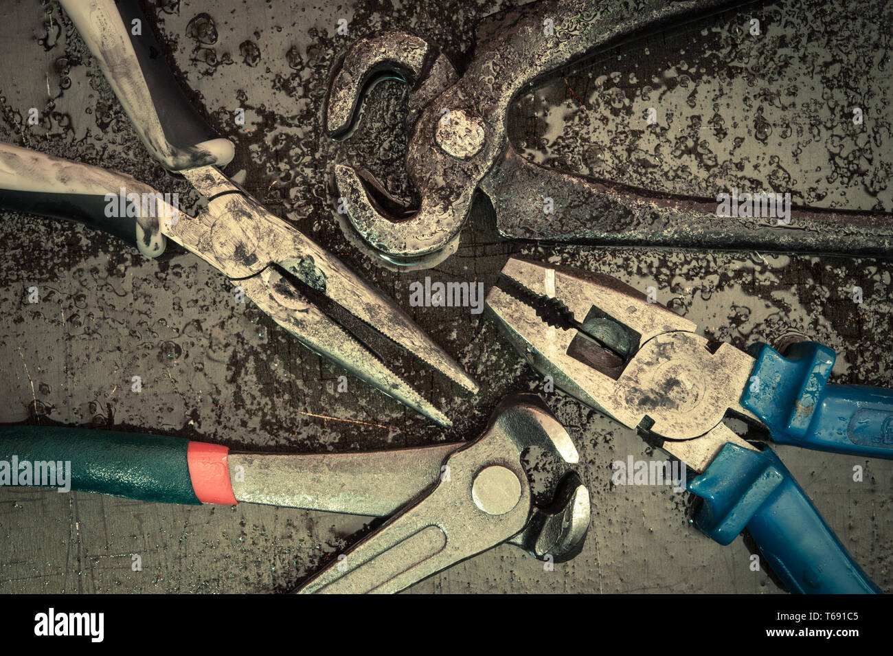 Various tools and instruments. Pincers, puller, pliers. - Stock Image