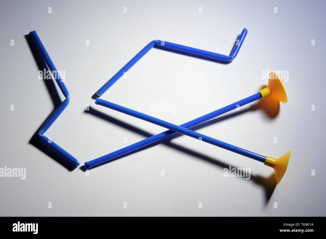 Broken Arrows with Suction Cups on White Background - Stock Image