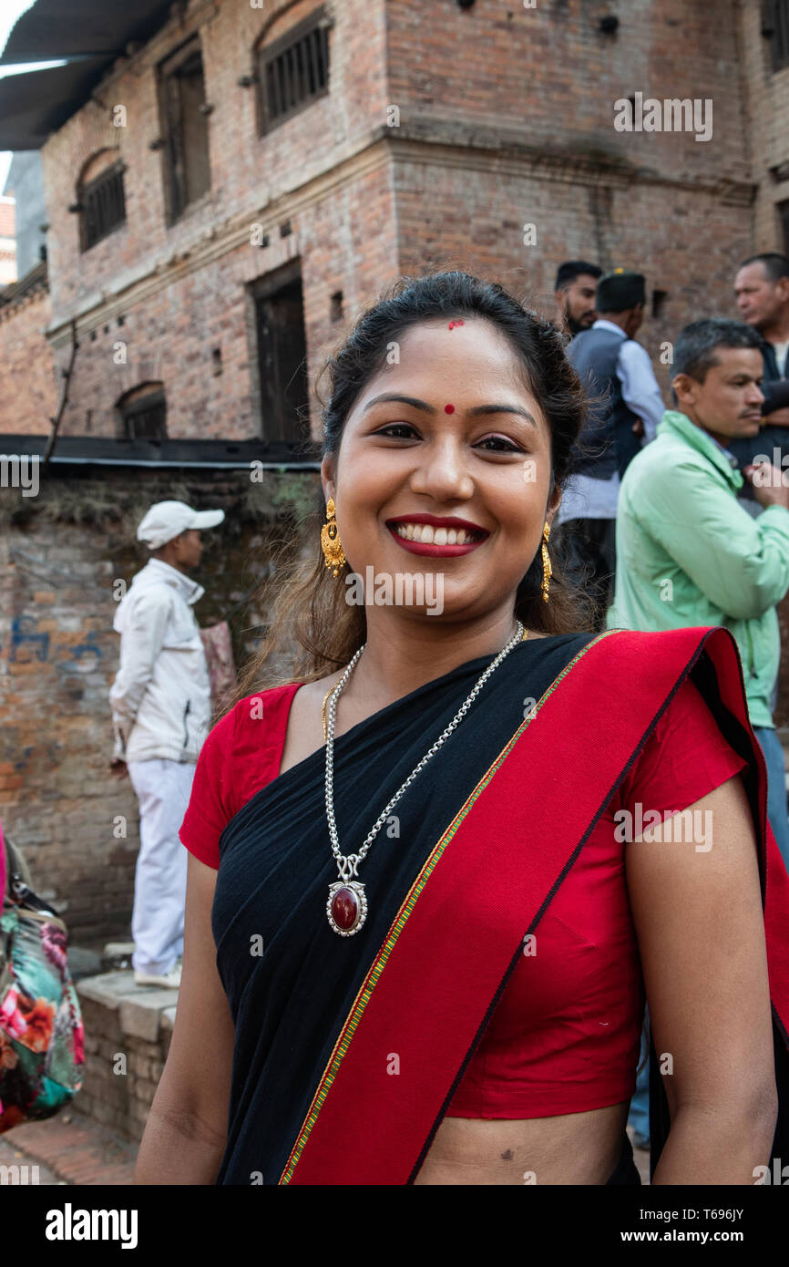Bhaktapur, Kathmandu Valley / Nepal - April 17th, 2019 - Nepali New Year celebrations showing 20 to 25 year old woman in the city. - Stock Image
