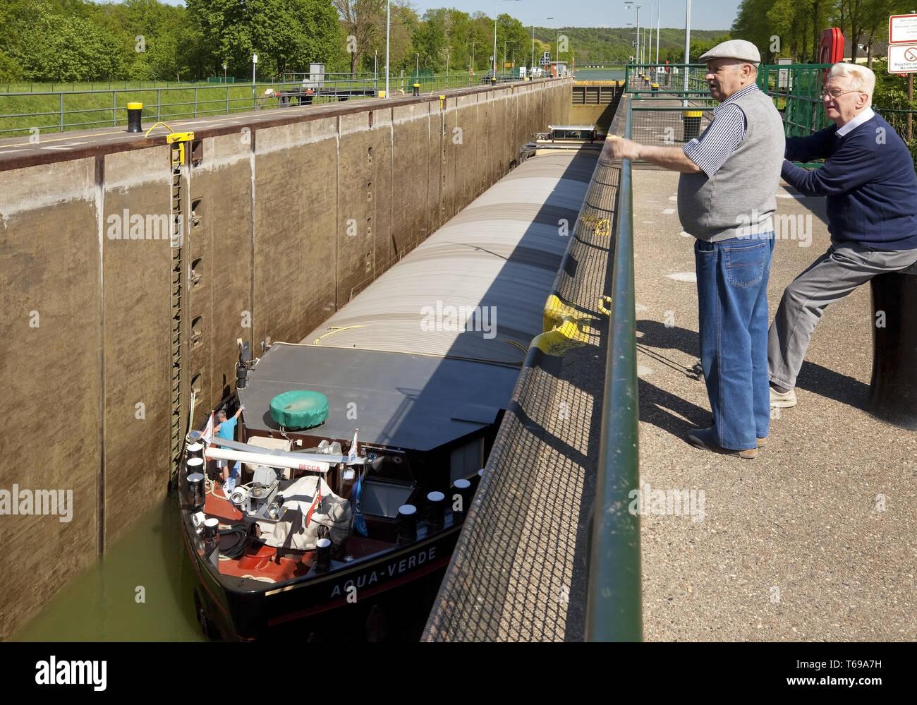 lock Bevergern with barge, Dortmund Ems Canal, Hoerstel, North Rhine-Westphalia, Germany - Stock Image