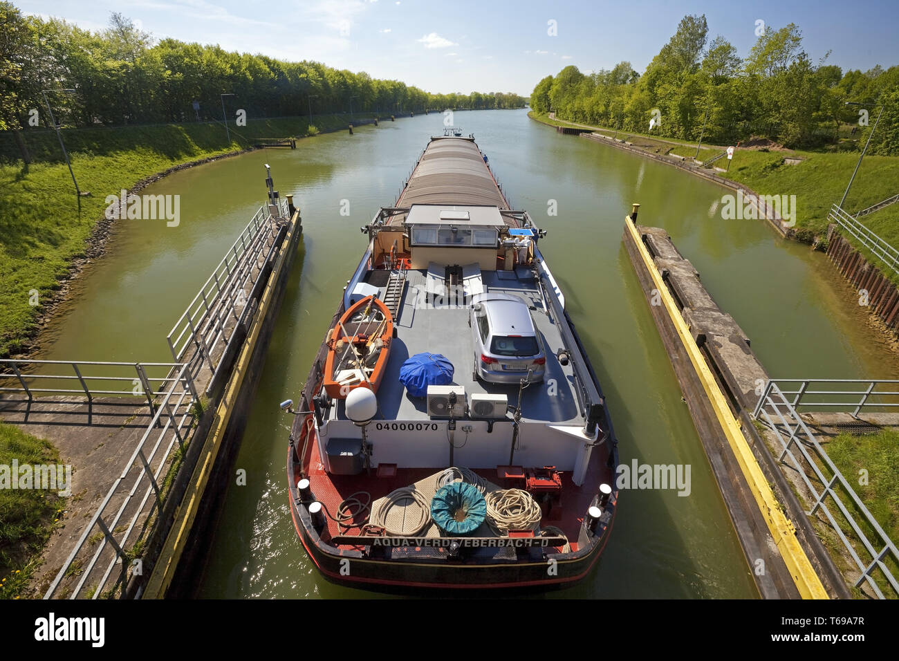 barge leaving the lock Bevergern, Dortmund Ems Canal, Hoerstel, North Rhine-Westphalia, Germany - Stock Image