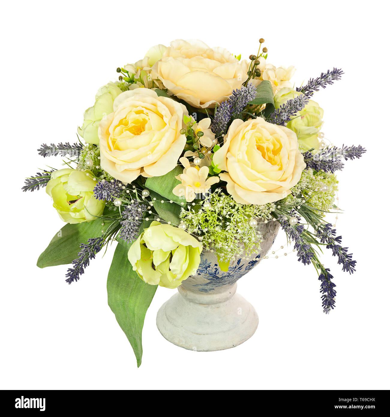Bouquet from artificial flowers arrangement centerpiece in old vase. Stock Photo
