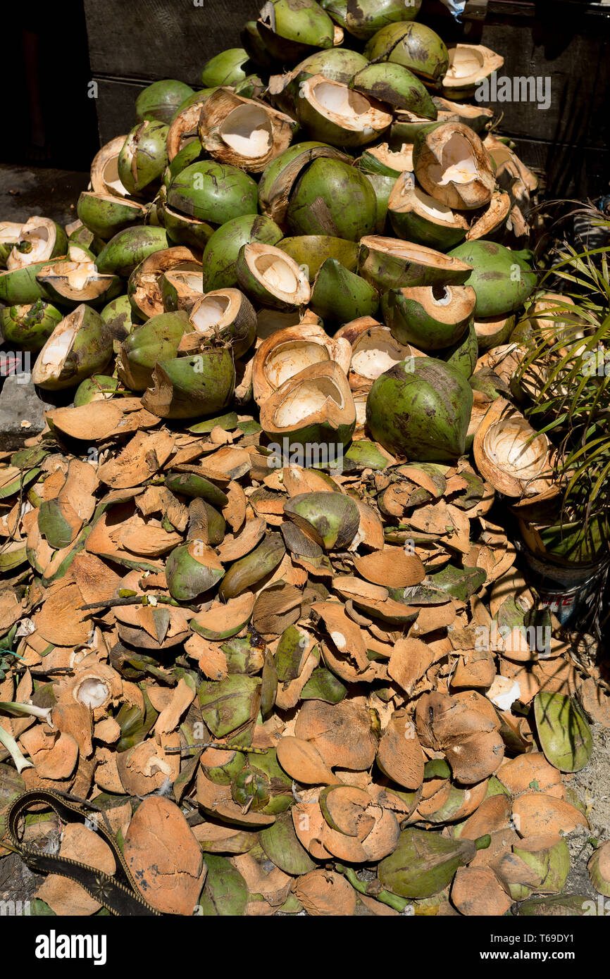 empty shels of fresh coconuts in the market Stock Photo