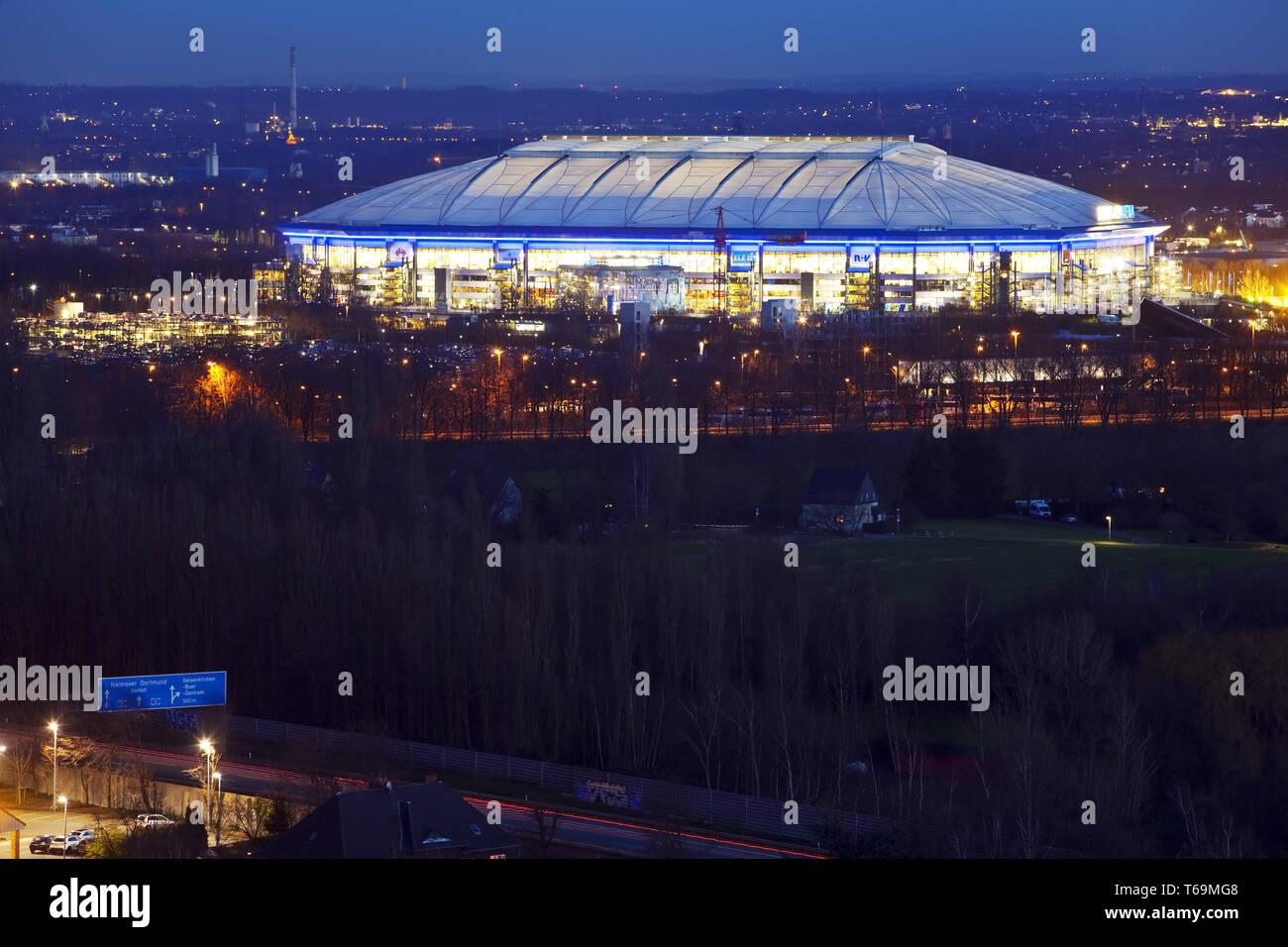 illuminated football stadium Veltins-Arena from Schalke 04 in twilight, Gelsenkirchen, Germany - Stock Image