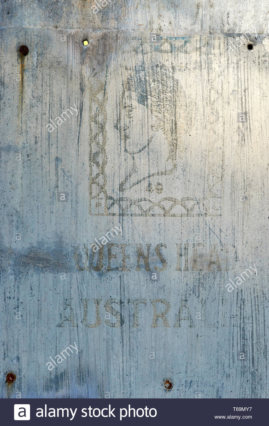 The 'Queens Head Australia' logo on an old flat sheet of galvanized iron - stamped for 1949 - popular metal cladding used in Australia last century. - Stock Image