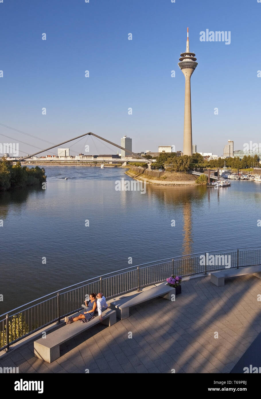 restaurant terrace with view onto the Rhine tower and the Gehry buildings, Duesseldorf, Germany - Stock Image