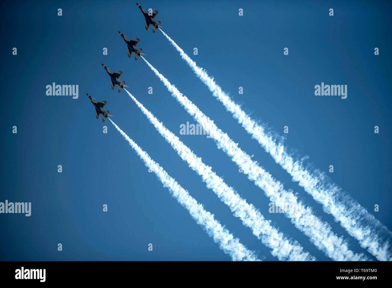 U.S. Air Force Thunderbirds perform a four-ship flyover during the Wings Over Wayne Air Show, April 27, 2019, at Seymour Johnson Air Force Base, North Carolina. The Thunderbirds demonstrated the versatility of the F-16 Fighting Falcon by performing aerial acrobatics, precision formations and high-speed passes during their performance.  (U.S. Air Force photo by Tech. Sgt. David W. Carbajal) - Stock Image