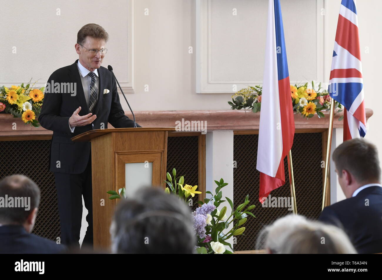 Prague, Czech Republic. 30th Apr, 2019. British Ambassador to the Czech Republic Nicholas Archer remembers organisers of children's rescue transport from Czech lands controlled by Nazi Germany to Britain in 1939 and thank families that accepted Czech children, on April 30, 2019, in Prague, Czech Republic. Credit: Michal Krumphanzl/CTK Photo/Alamy Live News - Stock Image