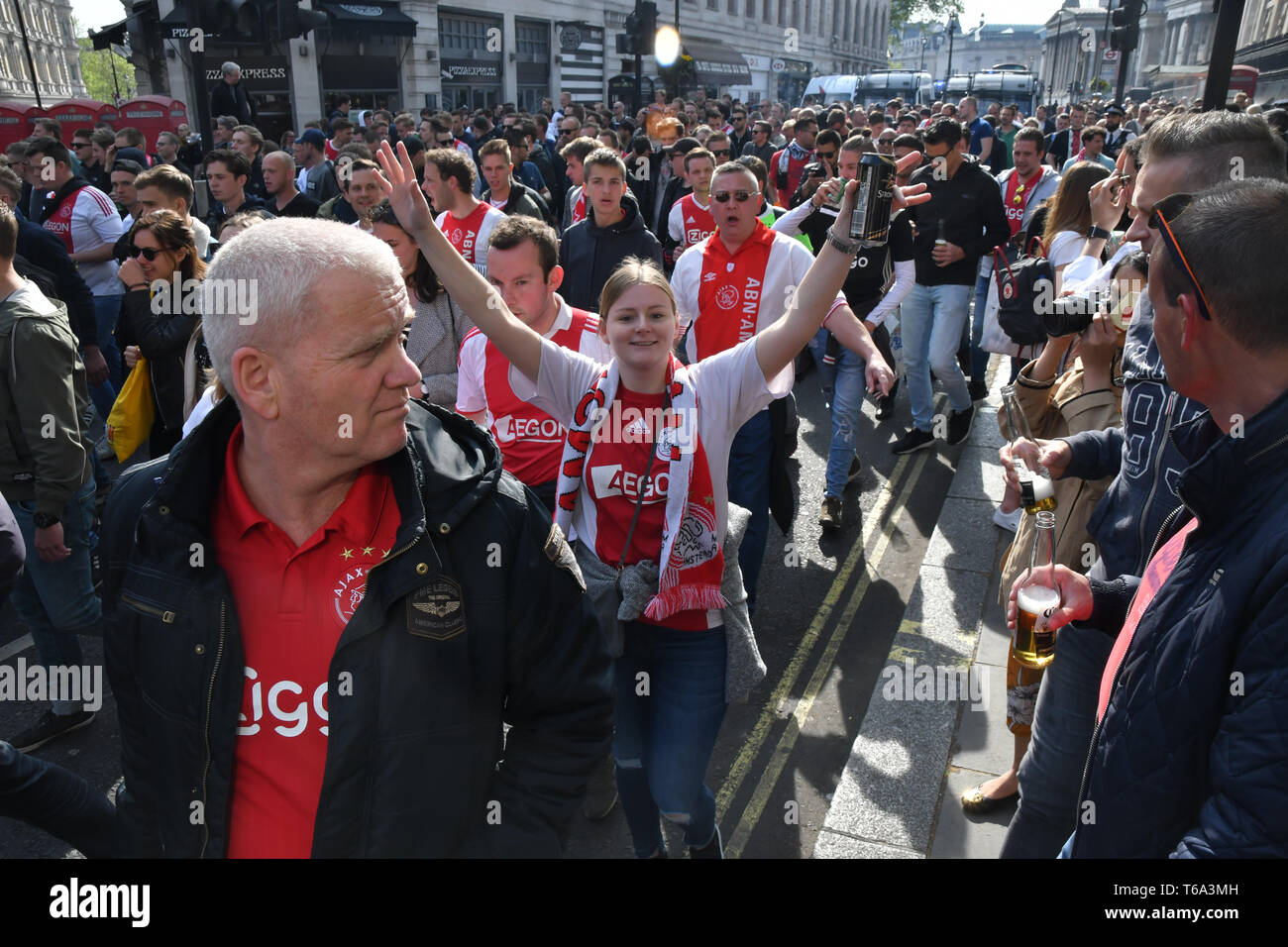 London, UK. 30th Apr 2019. AFC Ajax (ultras football)supporters march and salute in Charing Cross road, London, UK on 30 April 2019. Credit: Picture Capital/Alamy Live News Stock Photo