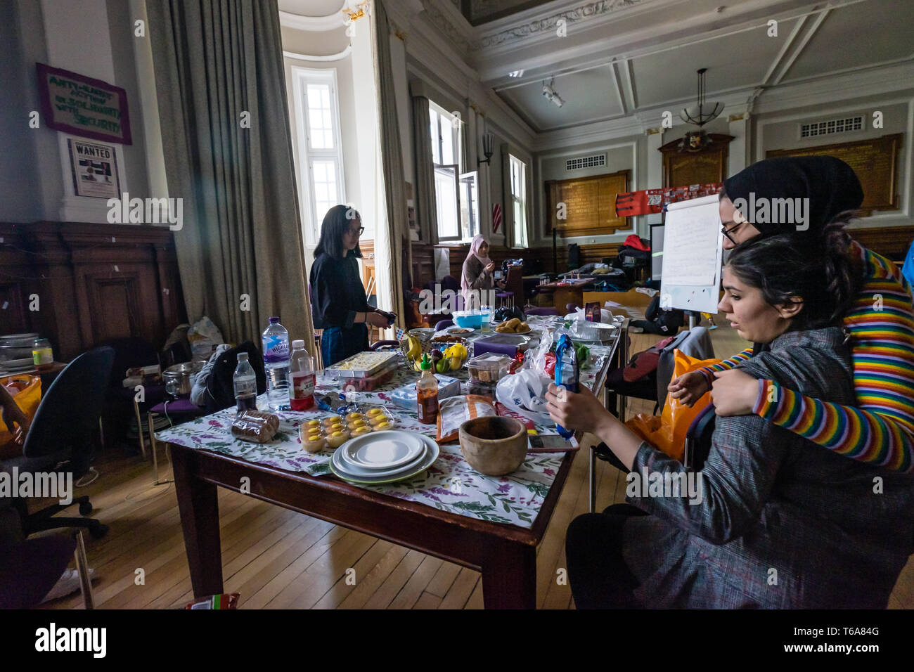 London, UK. 30th April 2018. Goldsmiths Anti-Racist Action celebrate 50 days of occupation of the management building, the former Deptford Town Hall and prepare food for a party. The occupation began when the university failed to respond adequately to racist abuse of a candidate in the student elections. Students claim the university fails to treat BAME students and workers fairly, and among other demands insist Goldsmiths produces a strategic plan to tackle racism. Credit: Peter Marshall/Alamy Live News Stock Photo