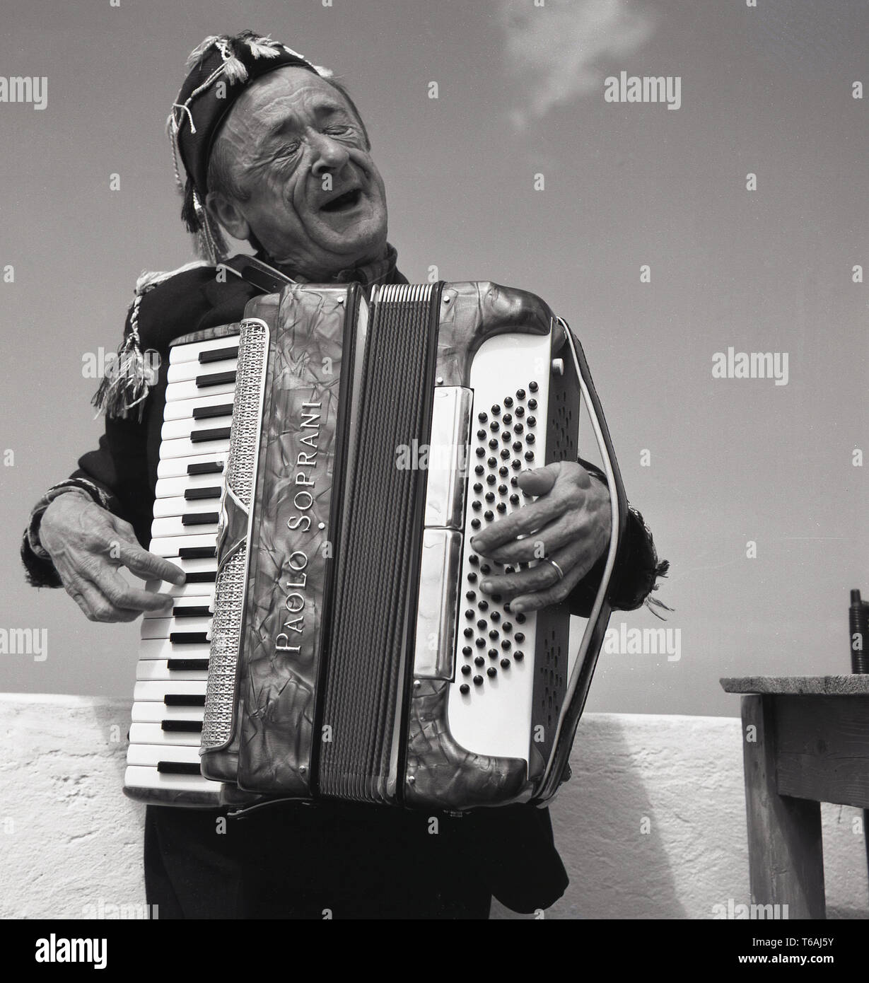 1950s, historical, male street musician or performer, an elderly man