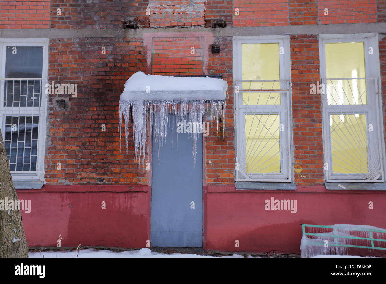Icicles on the cornice of the building - Stock Image