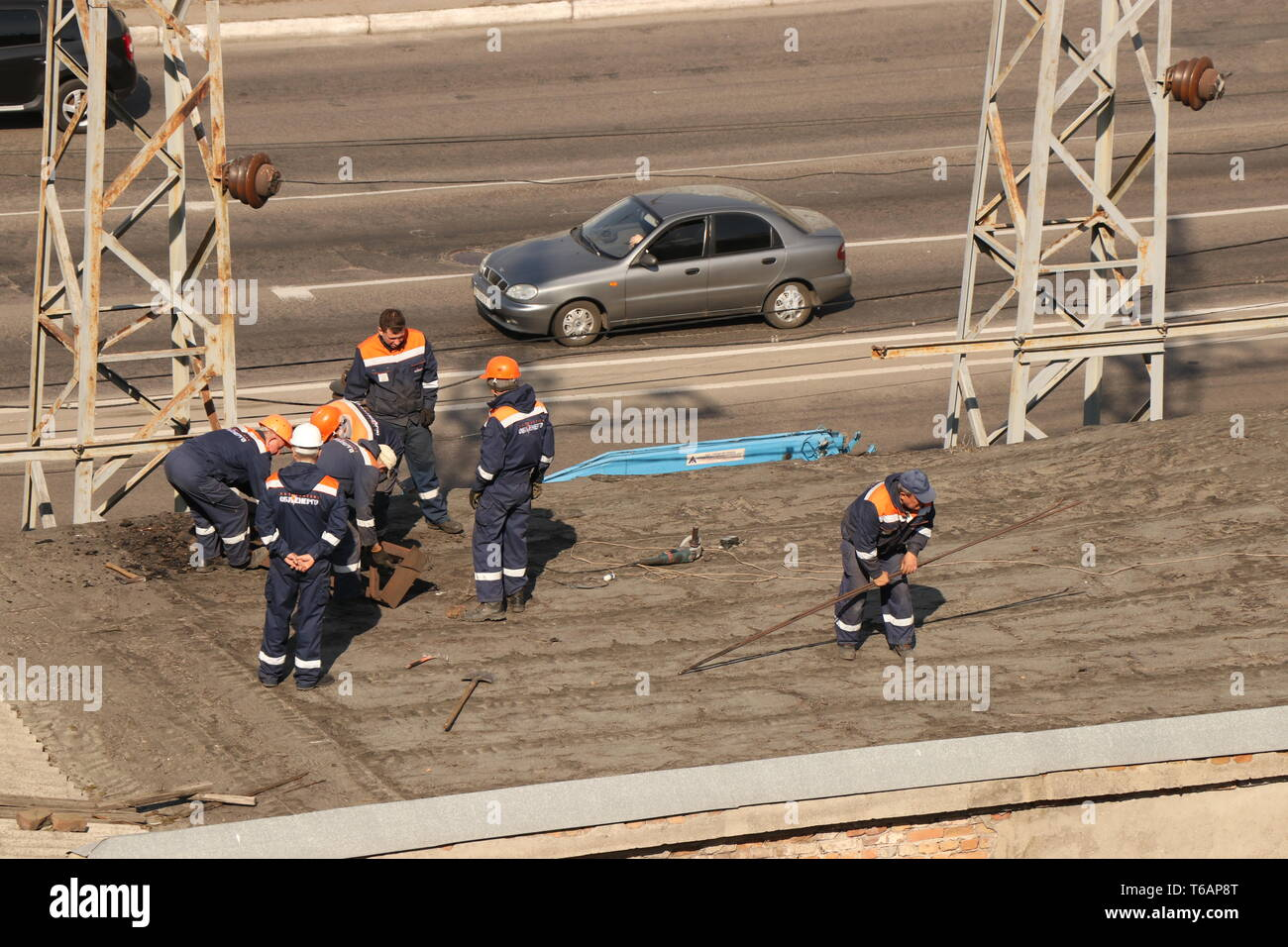 Kremenchug, Poltava region, Ukraine, April 9, 2019, improvement of the city, repair of power grids on the roof of the building Stock Photo