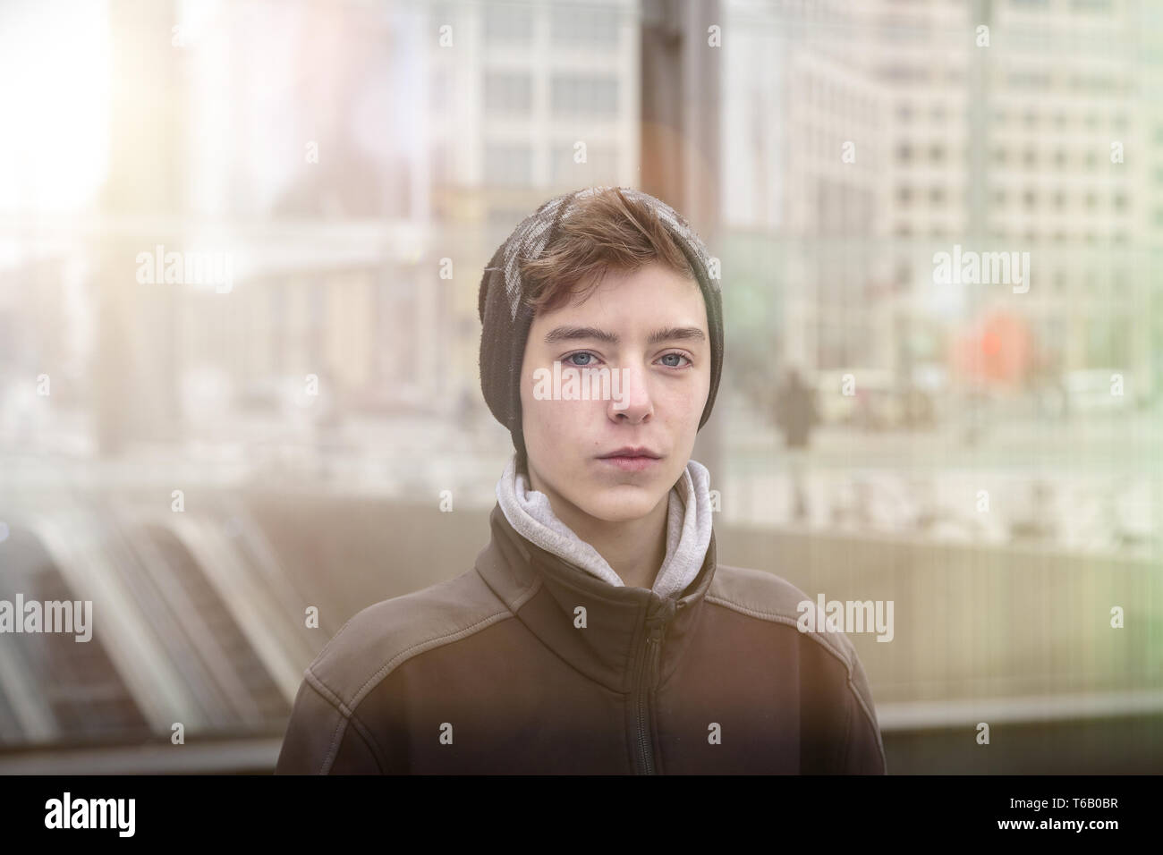 portrait of a beautiful teenage boy with winter clothes Stock Photo