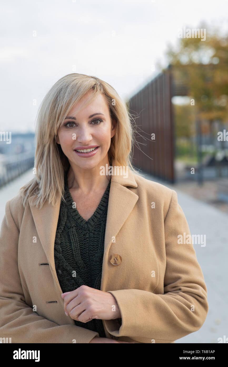 mature woman walking on promenade Stock Photo