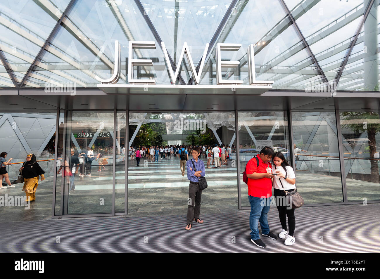 28.04.2019, Singapore, Republic of Singapore, Asia - People at the entrance to the new Jewel Terminal at Changi Airport. - Stock Image