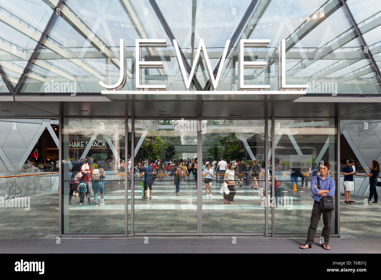28.04.2019, Singapore, Republic of Singapore, Asia - A man is waiting at the entrance to the new Jewel Terminal at Changi Airport. - Stock Image