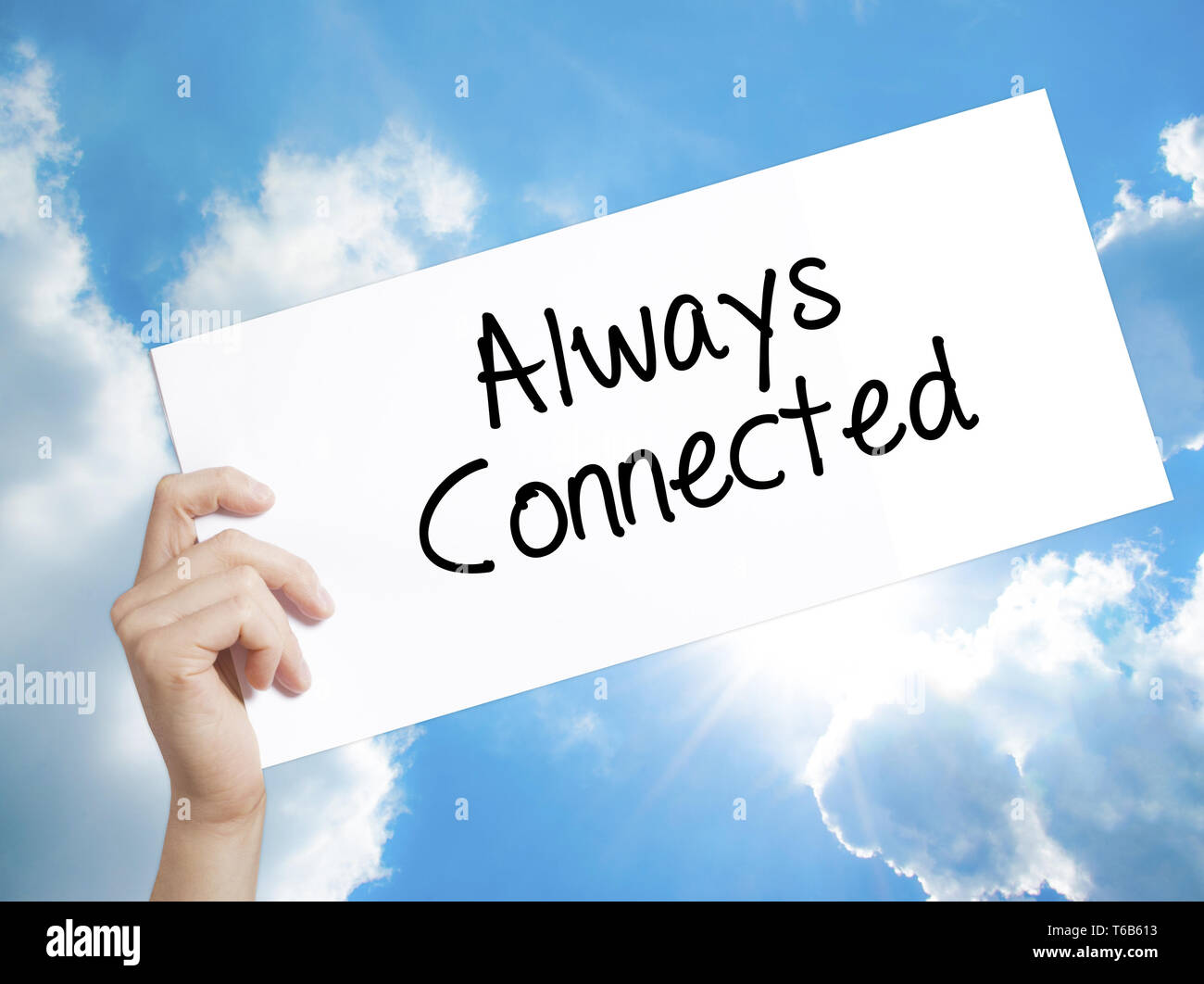 Always Connected Sign on white paper. Man Hand Holding Paper with text. Isolated on sky background. - Stock Image