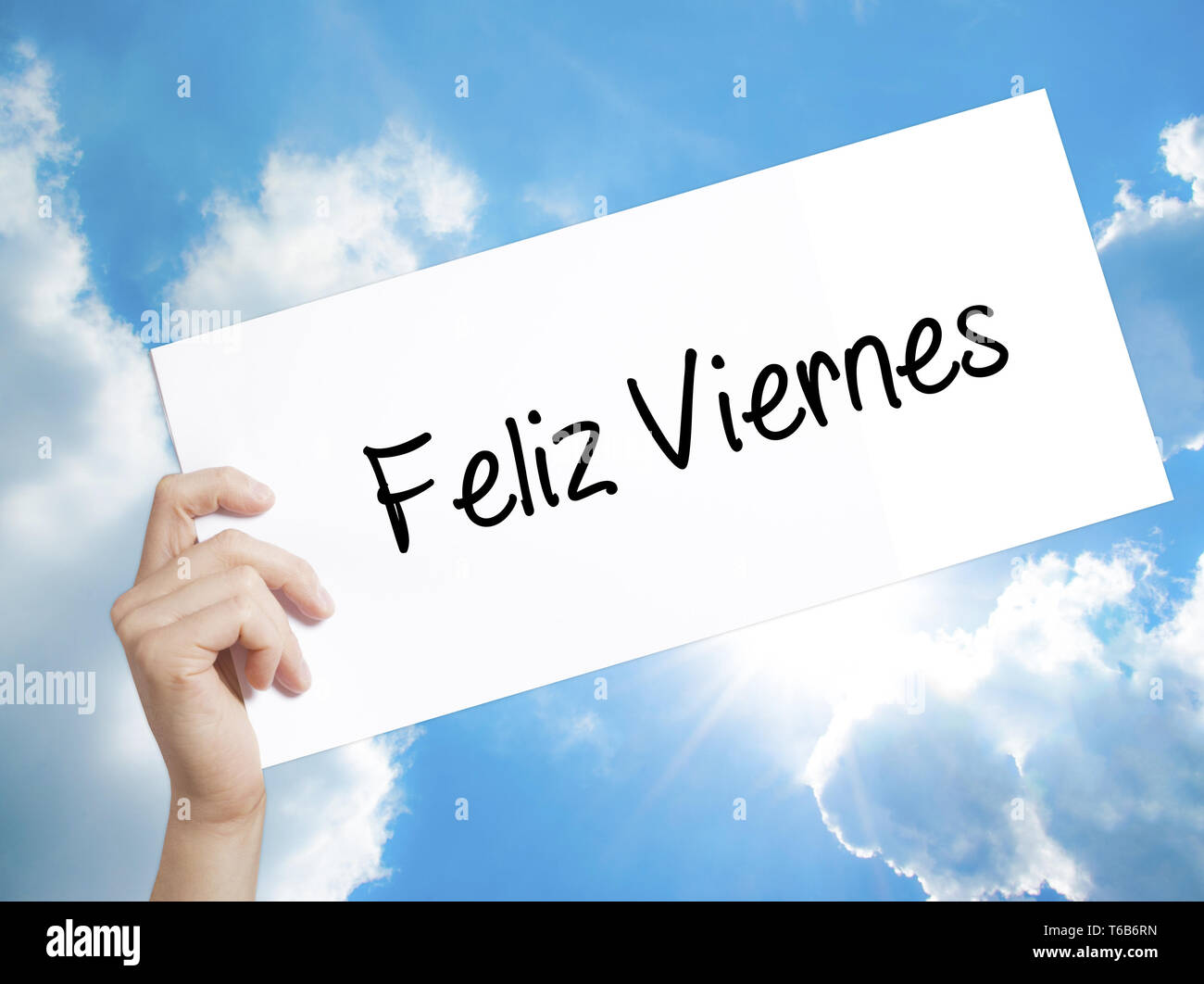 Feliz Viernes Happy Friday In Spanish Sign On White Paper Man Hand Holding Paper With Text Isolated On Sky Background Stock Photo Alamy