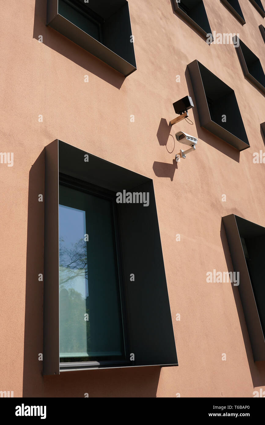 Surveillance camera on the facade of a house in Berlin - Stock Image