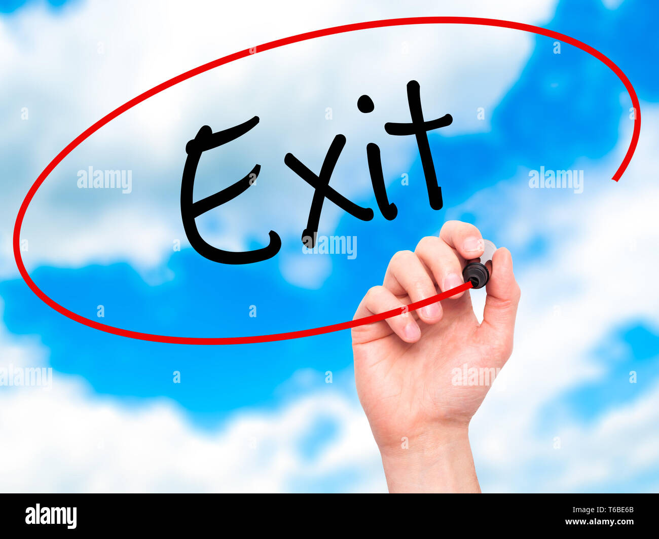 Man Hand writing Exit with black marker on visual screen - Stock Image