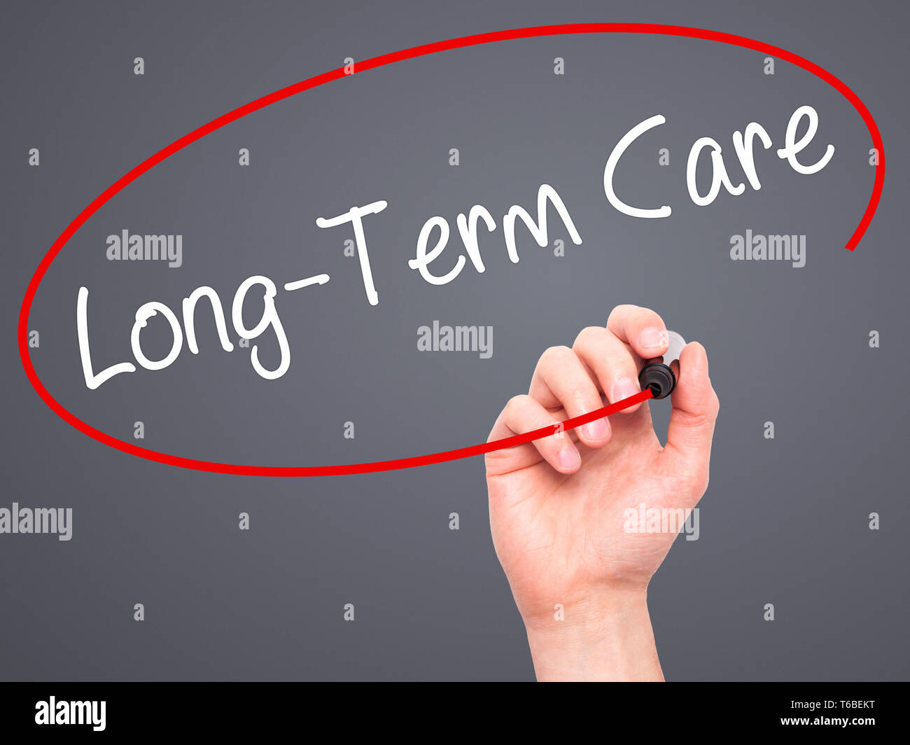 Man Hand writing Long-Term Care with black marker on visual screen - Stock Image